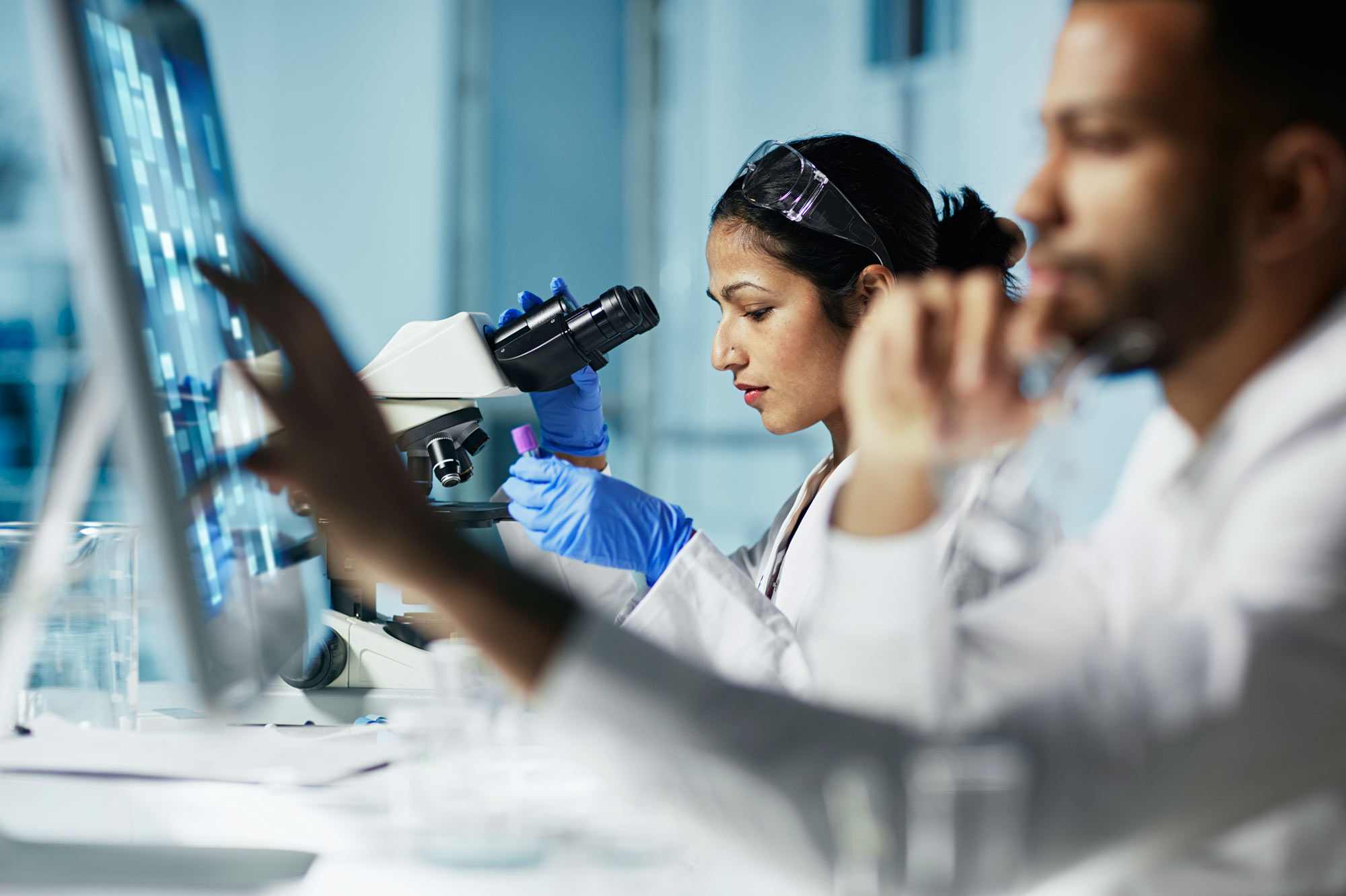 young-female-scientist-working-1090255620